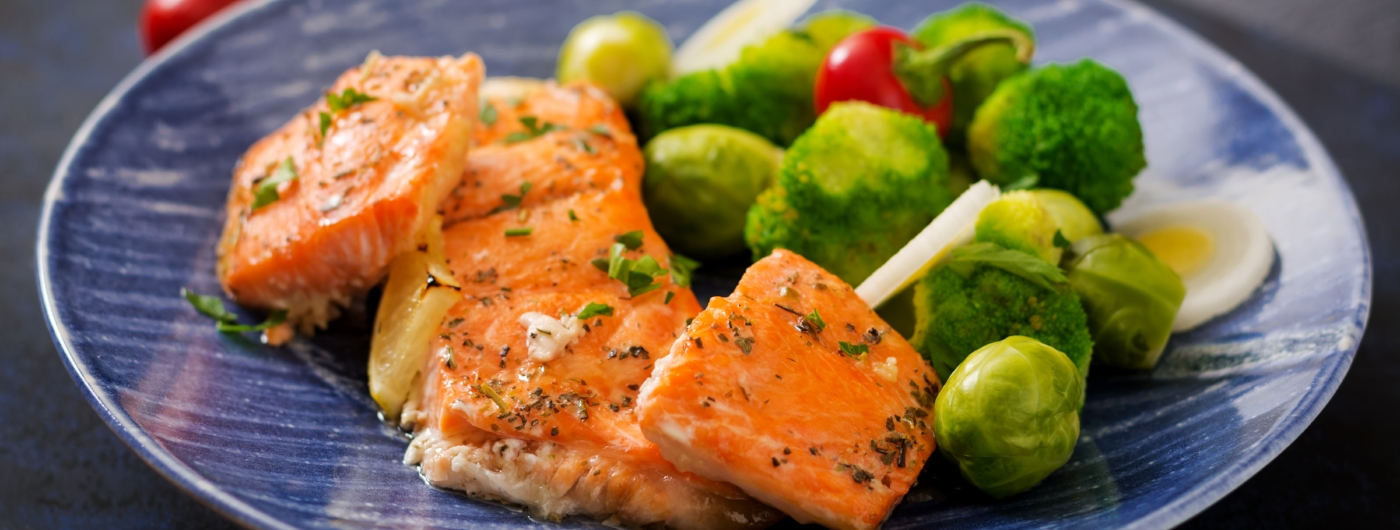 Baked salmon fish garnished with broccoli and Brussels sprouts