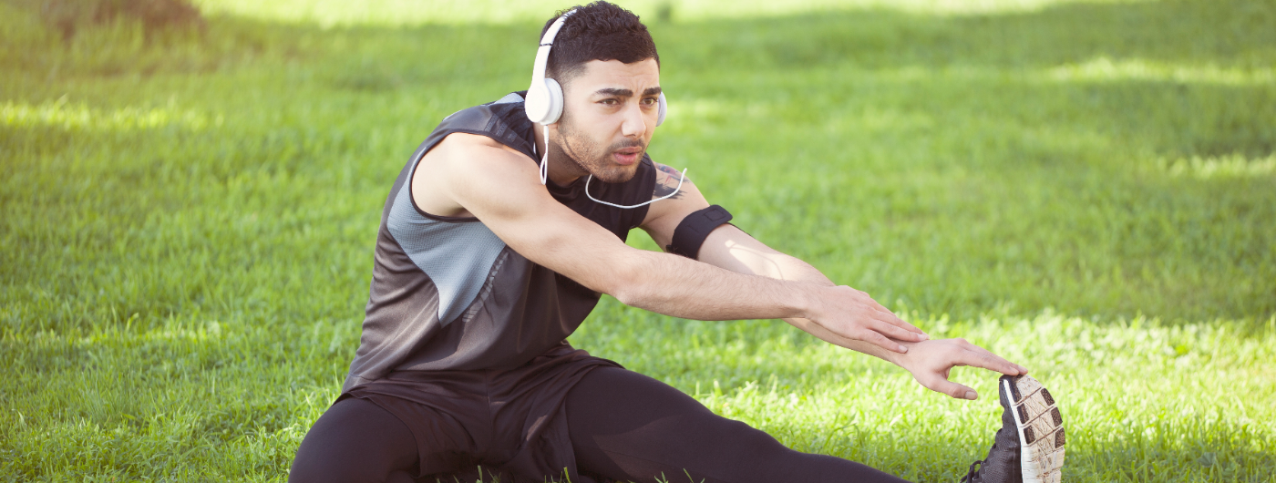 Young man exercising in park.